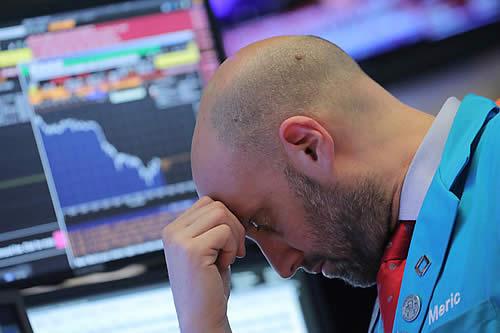 Augurios de recesión económica y una 'confusión china' derrumban el Dow Jones