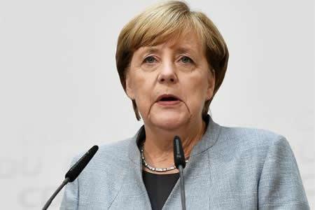 Merkel gana sus cuartas elecciones en un país sacudido por la ultraderecha